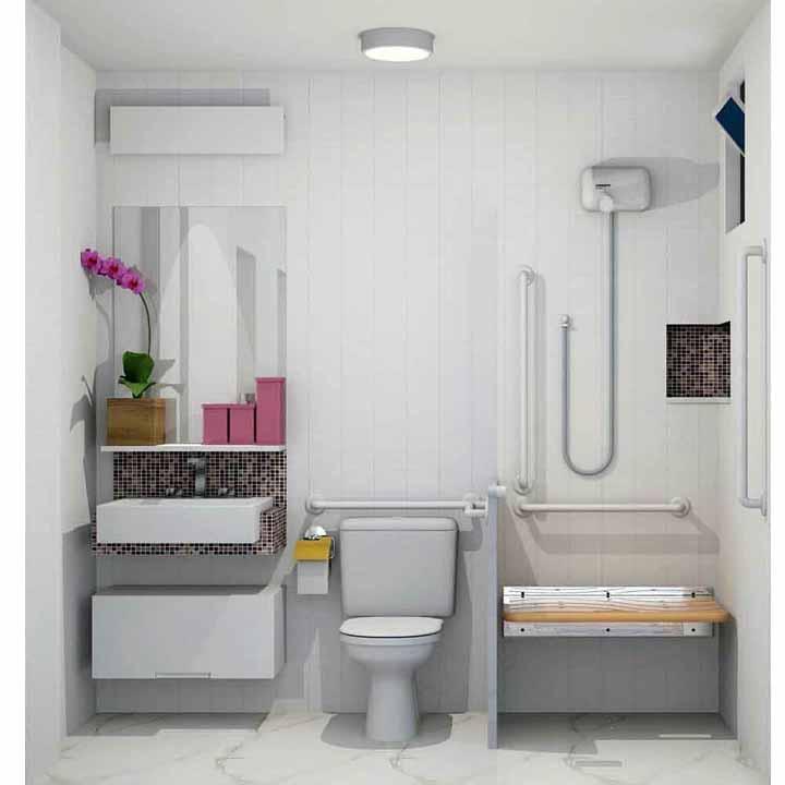 Banheiro para deficiente físico decorado com a elegância do vaso de orquídeas
