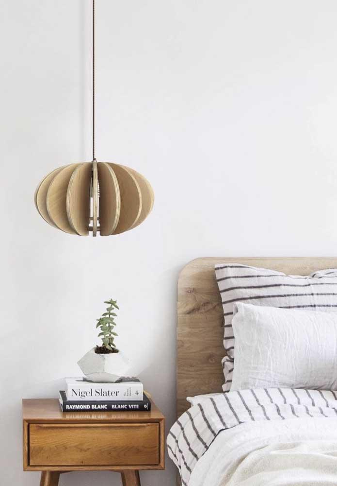 Combine a luminária com o restante da decoração do quarto