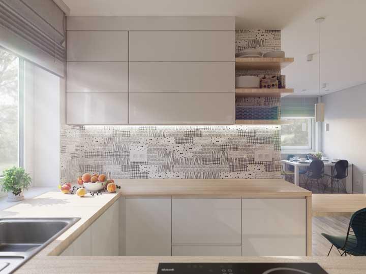 Adesivos e papel de parede também podem trazer uma bela contribuição visual para a cozinha, mas use-os, de preferência, em paredes sem umidade
