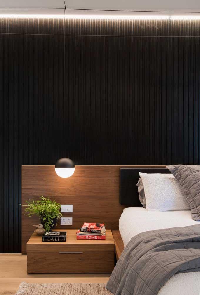 Ao invés de pintar na cor preta, use uma parede feita de pedaços de madeira na cor preta.