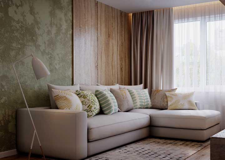 Use texturas diferentes em uma mesma parede para fazer uma decoração ousada na sua sala.