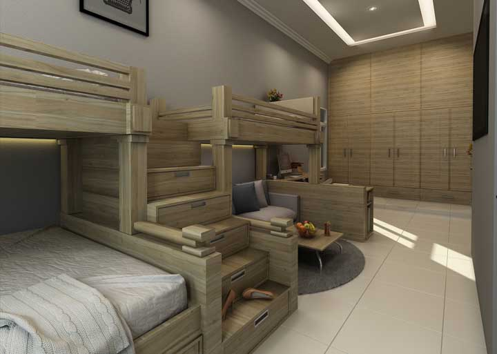 Se você tem mais de dois filhos, esse modelo de beliche é ideal. Cada criança fica com a sua cama, os degraus da escada se transformam em gavetas e dá até para fazer uma sala de estar.