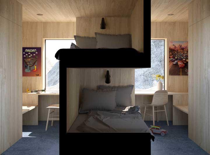 Com as camas do beliche viradas para o lado oposto da janela, permite que as crianças tenham mais conforto na hora de dormir, além de aproveitar a área da janela para fazer uma mesa enorme de estudos.