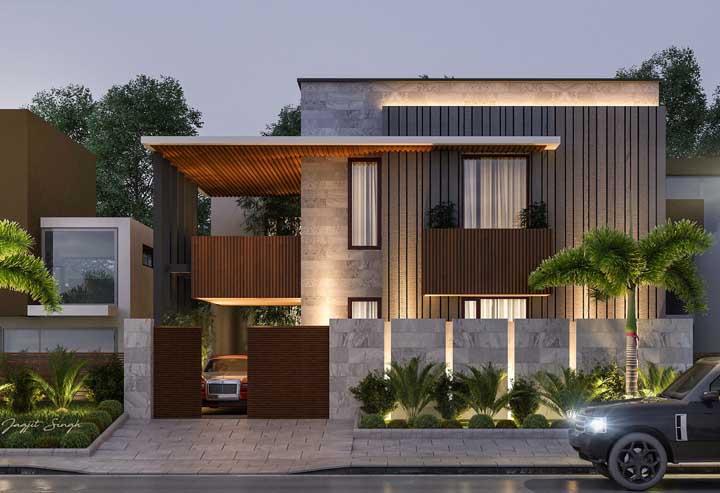 Para criar uniformidade na fachada, procure manter o mesmo padrão de cores e materiais nas paredes e no muro