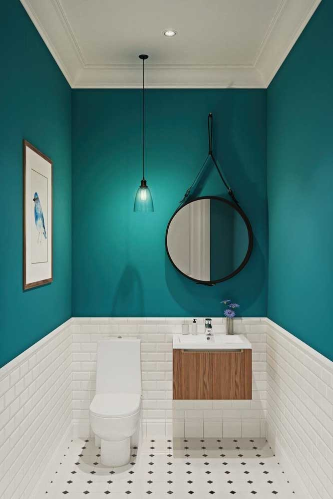 Gabinete de banheiro pequeno com cuba embutida e duas portas: um clássico; repare que o quadro na parede acompanha as cores do móvel