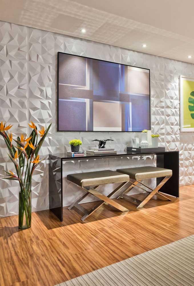 O efeito 3D na parede da sala ficou incrível; destaque para a TV que não precisou de painel ou estante