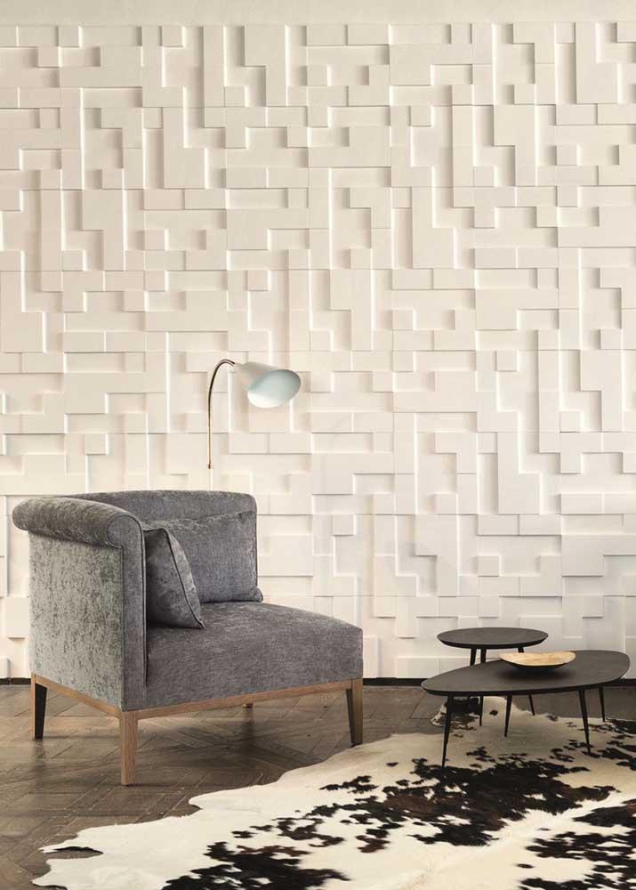 Transforme o cantinho da leitura com a parede de gesso 3D; aqui, objetos decorativos se tornam dispensáveis com o conceito que a parede deixou transparecer