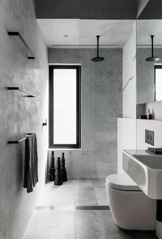 Preto, branco e cinza formam esse modelo de banheiro moderno e minimalista