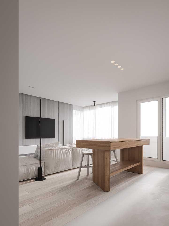 Piso vinílico para o ambiente integrado; o piso garante a uniformidade e a continuidade visual