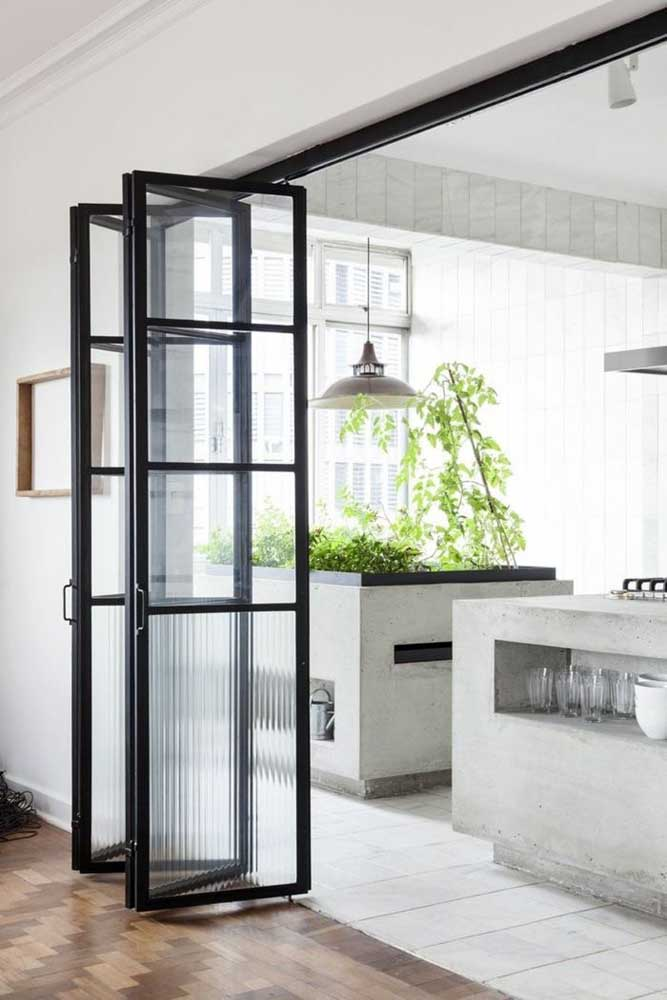 Portas de vidro dobrável integrando ambientes