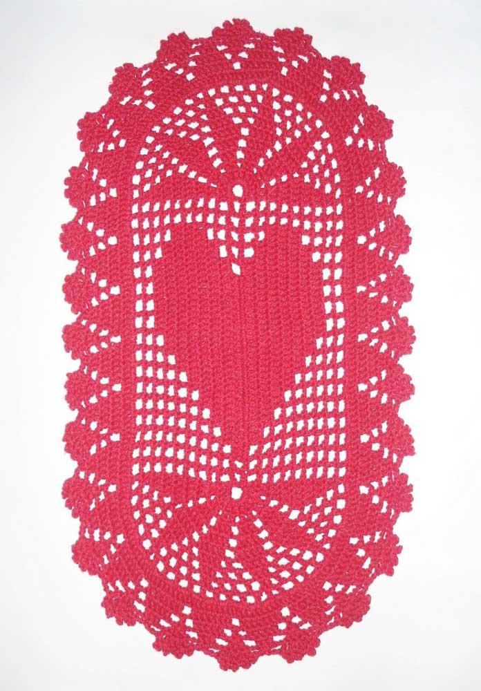 O coração no centro do tapete dá um toque romântico ao tapete