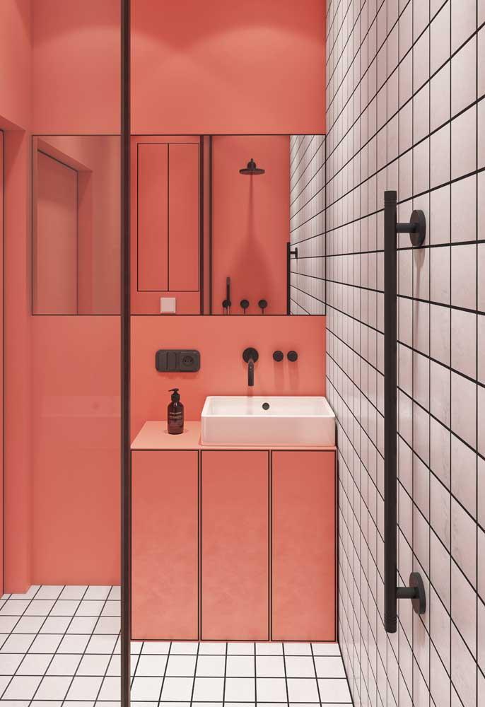 A cor do ano, a Livind Coral, foi a escolhida para colorir esse banheiro moderno