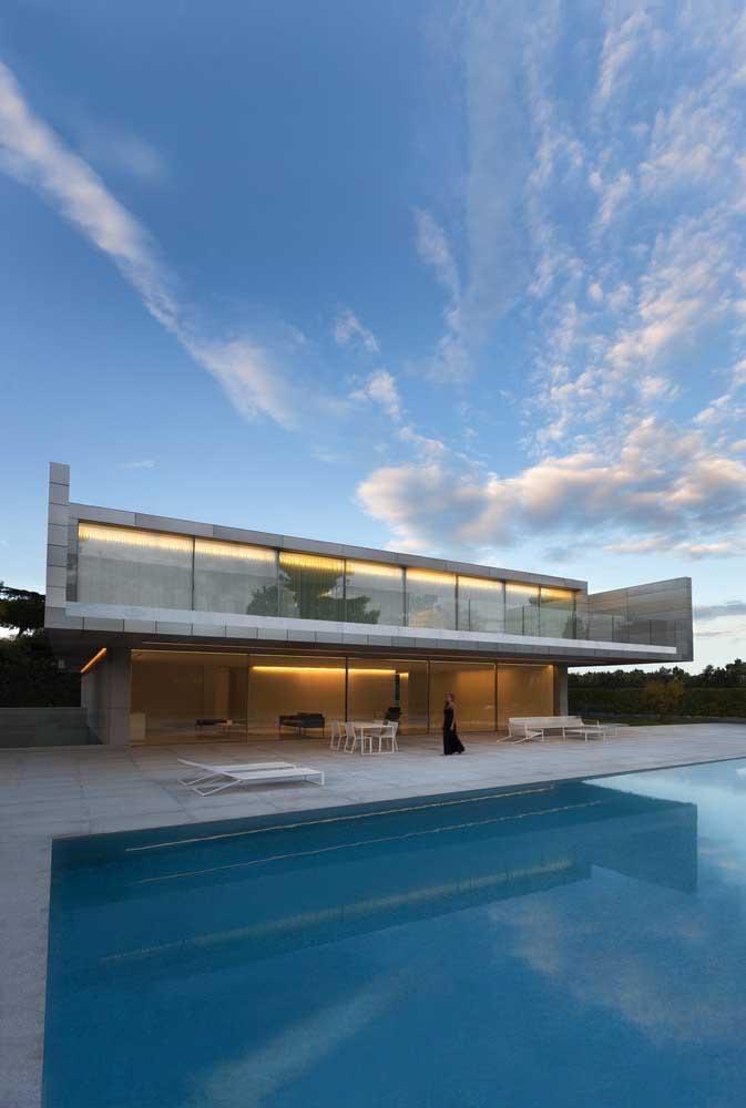 Conceito moderno e minimalista de casa onde o projeto de iluminação é o ponto alto