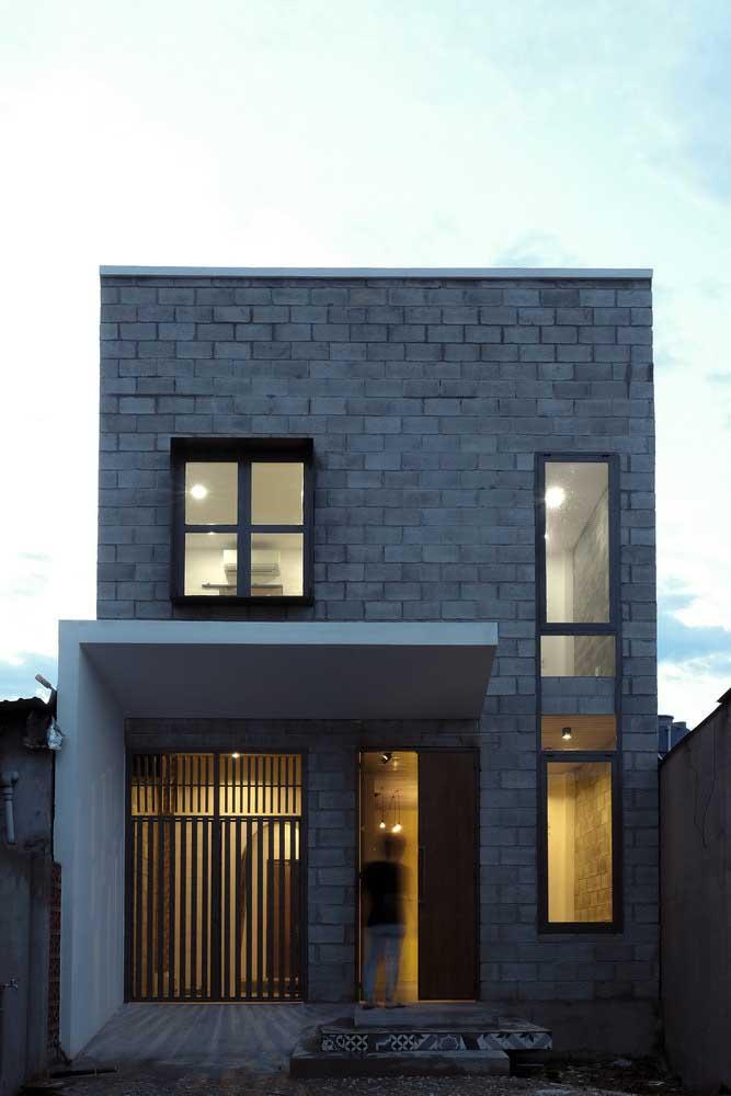 Fachada de casa pequena moderna com revestimento de tijolinhos