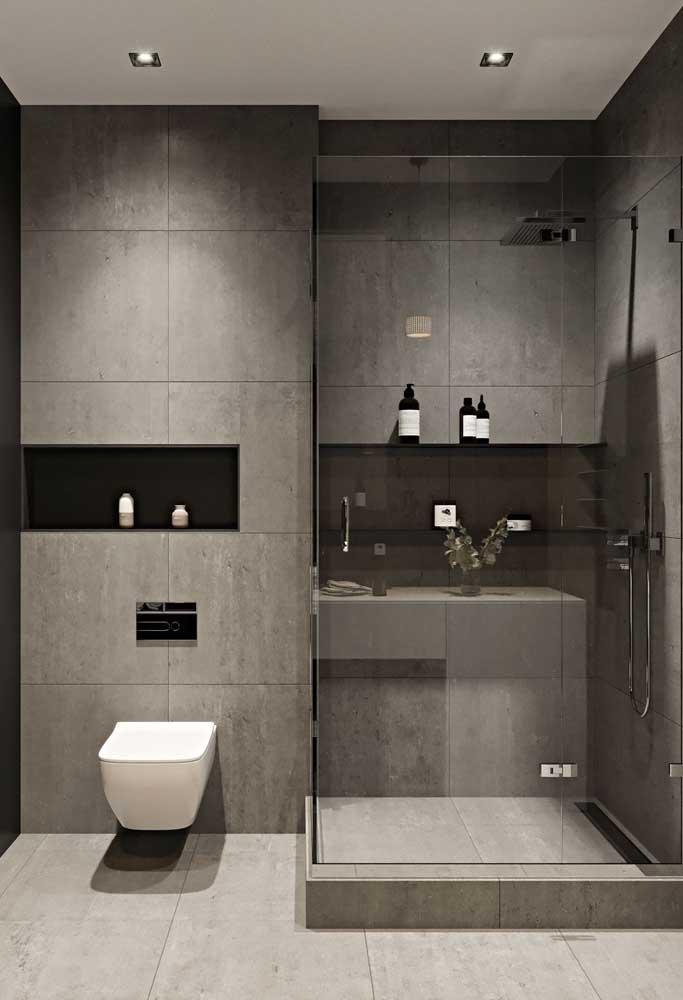 Banheiro moderno com cerâmica cinza e detalhes preto