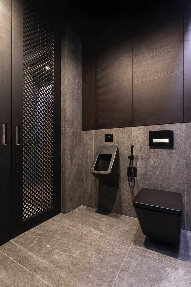 A cerâmica para banheiro cinza também se destaca por aqui, mas com o diferencial de imitar a textura do cimento queimado