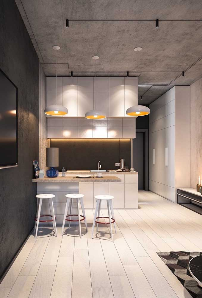 Cozinha americana pequena integrada com influência do estilo industrial