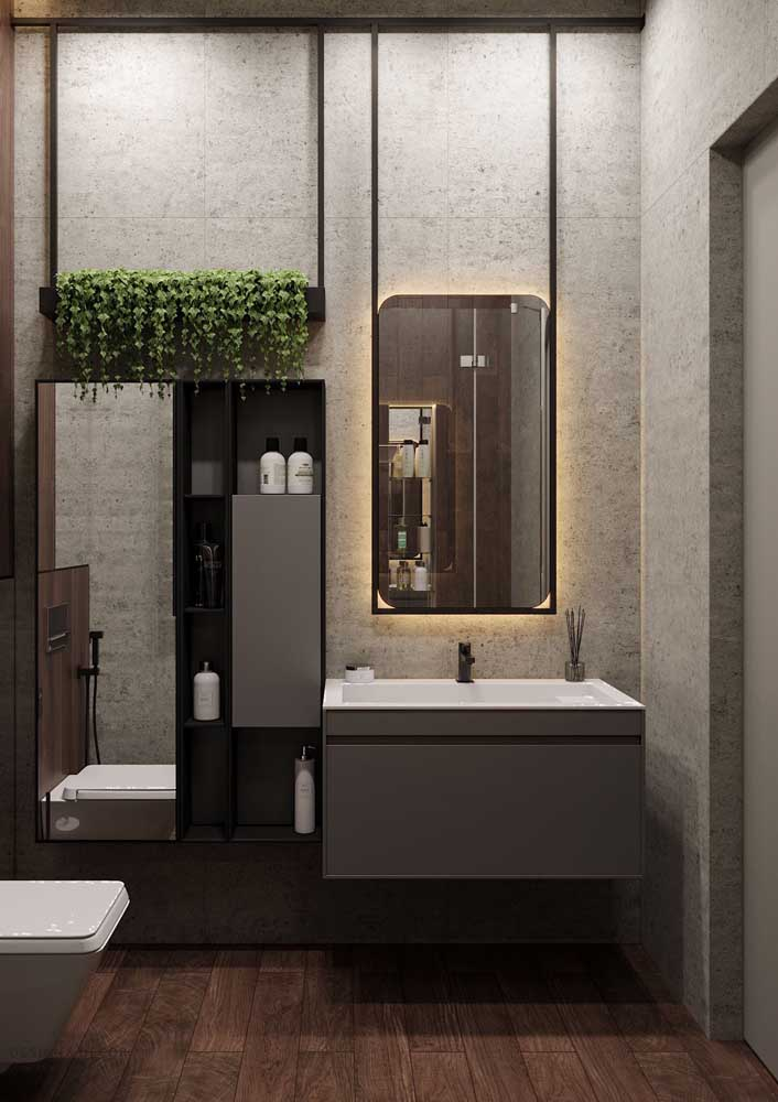 Detalhes modernos envolvem o espelho retangular com bordas arredondadas e luz de fundo