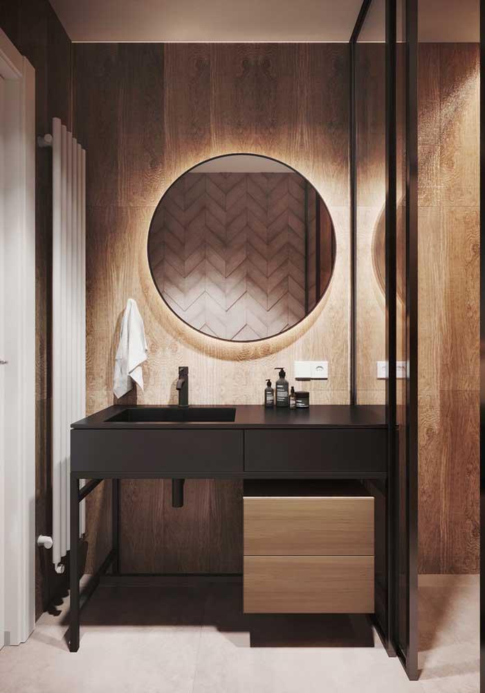 Espelho redondo com borda em ferro e iluminação invisível em led: ideal para propostas modernas e industriais