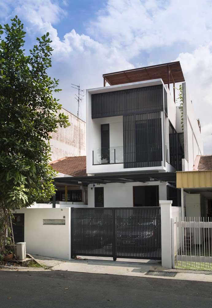 Fachada de casa simples com direito a muro, portão e garagem