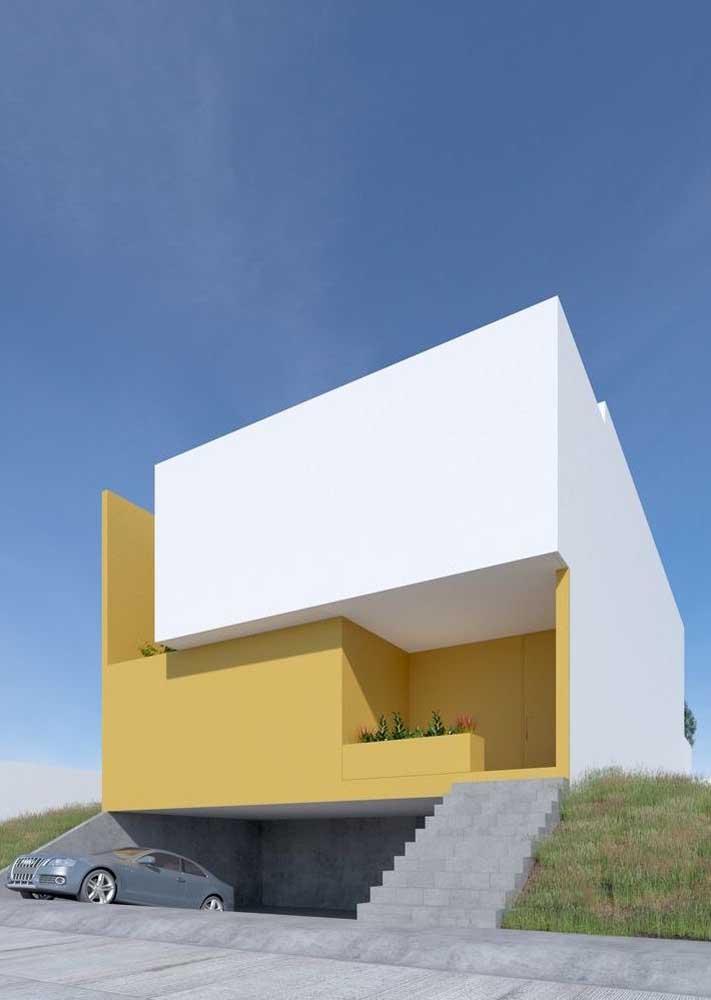 Já aqui, os tons de branco e mostarda fazem um belo contraste e revelam uma fachada de volumes e formas modernas