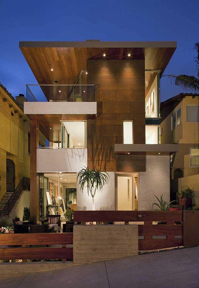 Fachada moderna exuberante com volumes e formas marcados pela iluminação indireta