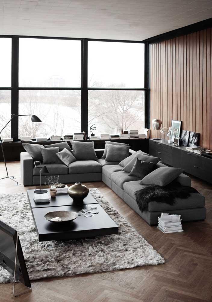 Sala planejada moderna e elegante com destaque para o sofá