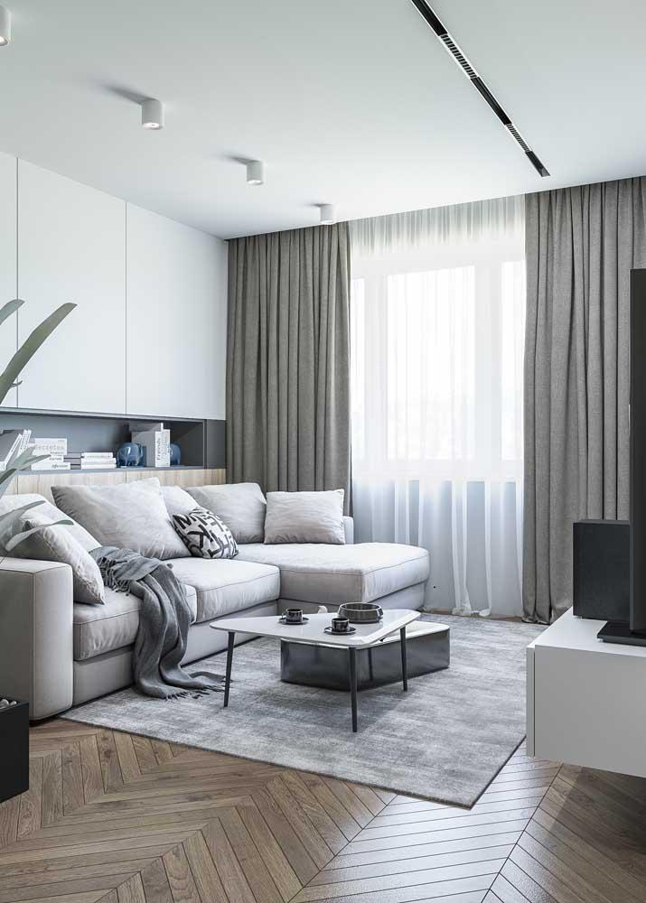 Tons de cinza garantem o visual sóbrio, clean e moderno da sala planejada