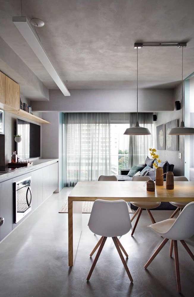 Sala e cozinha integradas; aqui, o projeto contempla ambos os espaços com as mesmas características visuais