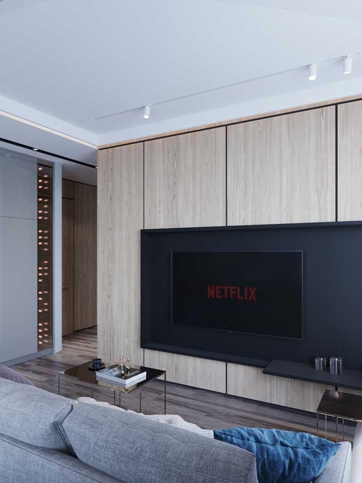 Um painel especial para destacar a estrela da sala: a TV