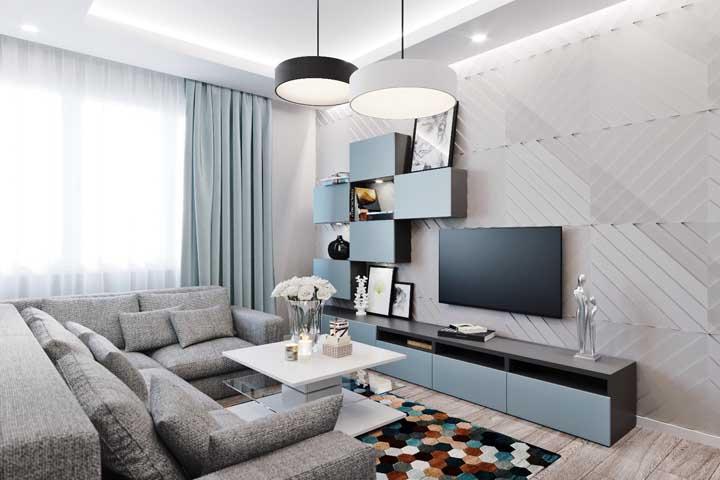 Sala pequena, moderna e planejada, ideal para um apartamento