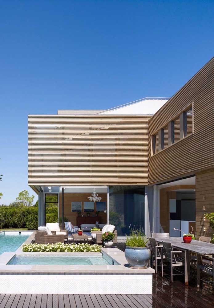 Casa em L com varanda super convidativa e aconchegante