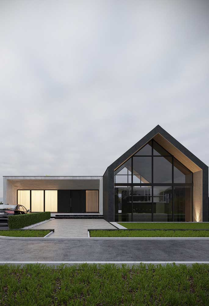 Casa moderna com fachada de vidro e alvenaria