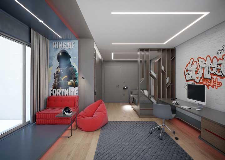 O grafite na parede garante o toque urbano e jovial a esse projeto de quarto gamer