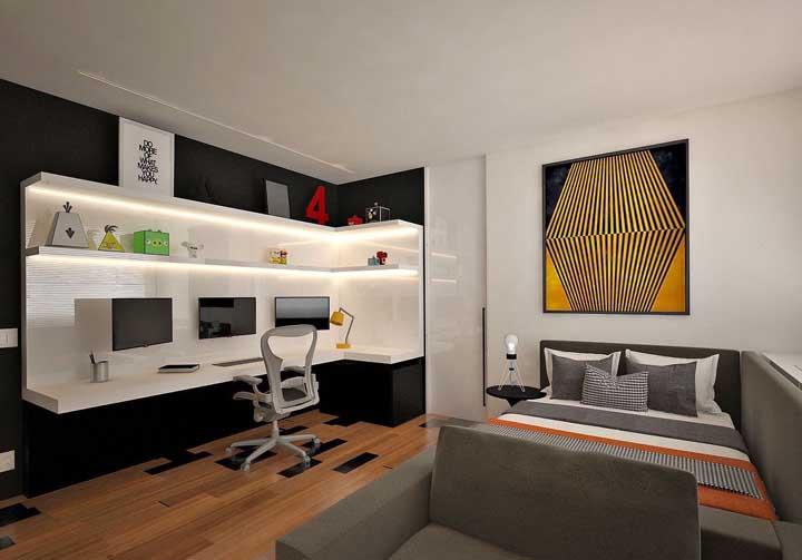 Inspiração de quarto gamer com uma decoração clean, mas cheia de impacto visual graças ao uso de cores contrastantes