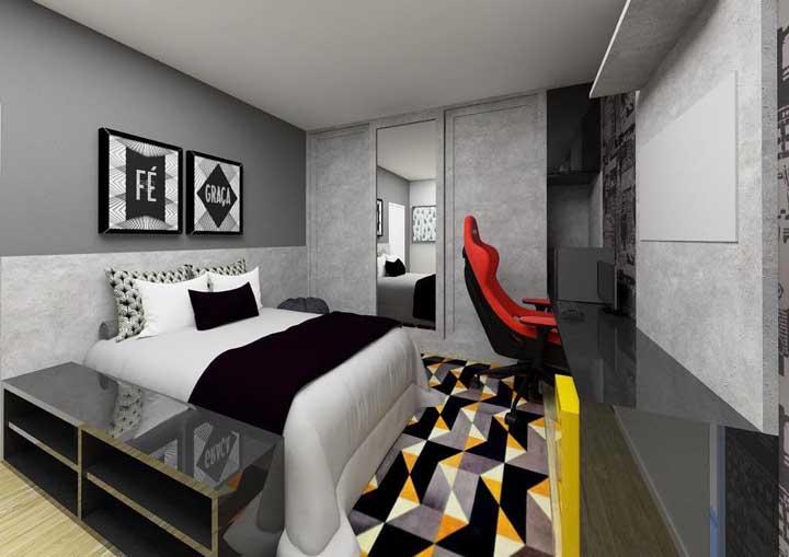 O preto, o cinza e amarelo fazem a vez nesse outro quarto gamer; um dos trios de cores mais escolhidos para esse tipo de quarto