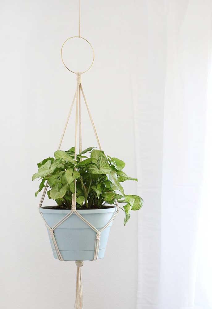 O vaso de plantas também recebeu o charme e a beleza do String Art