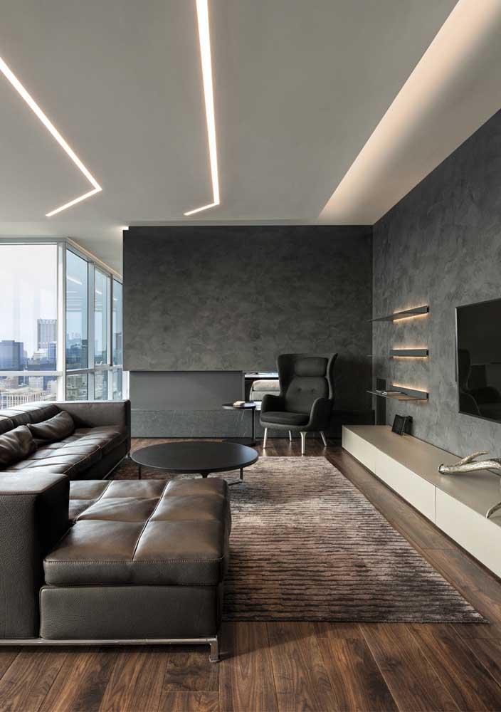 Teto de gesso com faixas de LED valorizando o conceito moderno da sala de estar
