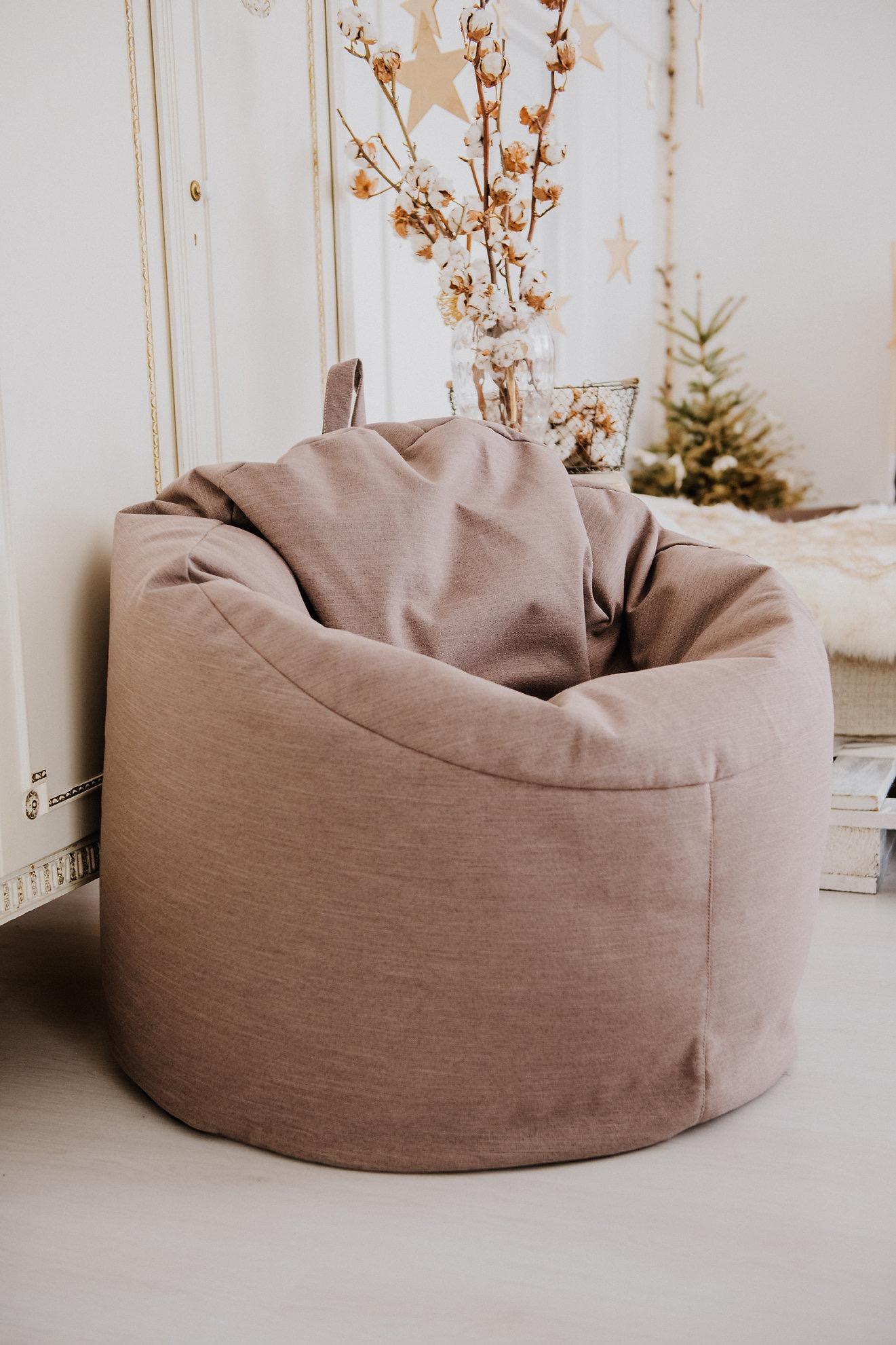 Se a decoração da sua casa é mais clean, o ideal é escolher um puff redondo no tom mais neutro.