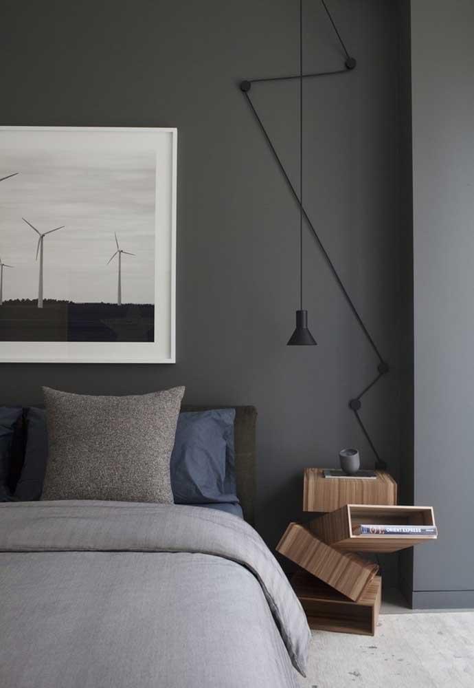 Aposte em objetos decorativos com design diferenciado para deixar o quarto cinza mais moderno.
