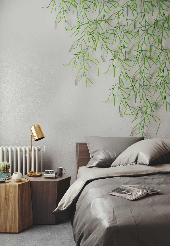Perceba como o detalhe da planta na parede faz toda a diferença na decoração.