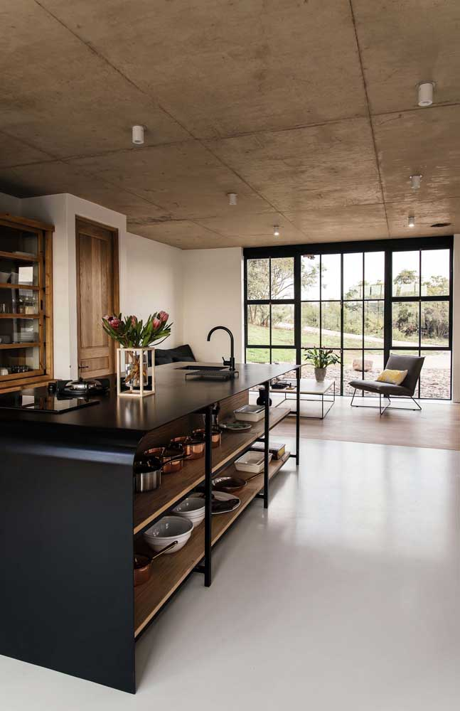 Bancada ilha de cozinha com cuba e cooktop feita em uma única placa metálica moldável; proposta super moderna e original