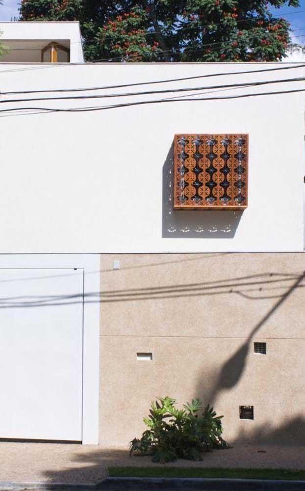 A estrelinha da fachada: a grade de ferro desenhada