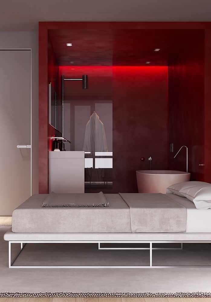 Se o banheiro for conjugado com o quarto como nesse modelo, você pode usar a cor vermelha só no banheiro.