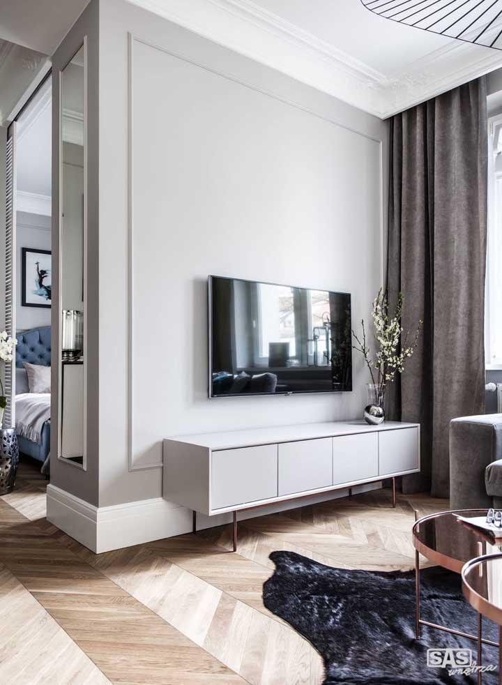 Deixe a sua sala de estar mais elegante com a moldura de Boiserie.