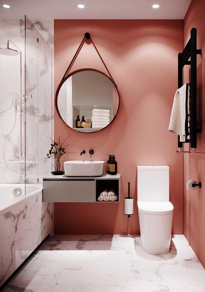 Que tal combinar cores como rosa e branco para deixar o banheiro mais harmonioso?