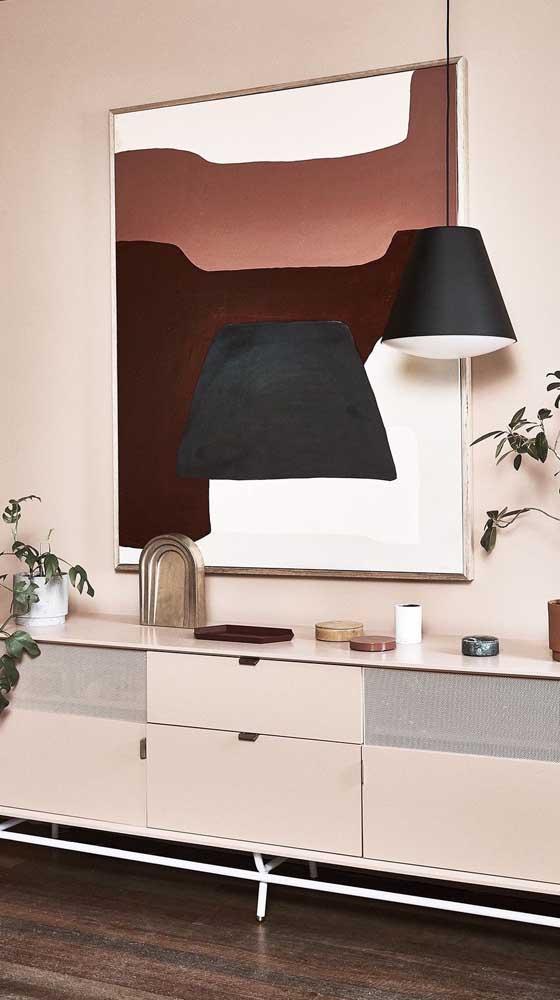 Olha que ideia genial da pintura do quadro ser a luminária que está decorando o ambiente.