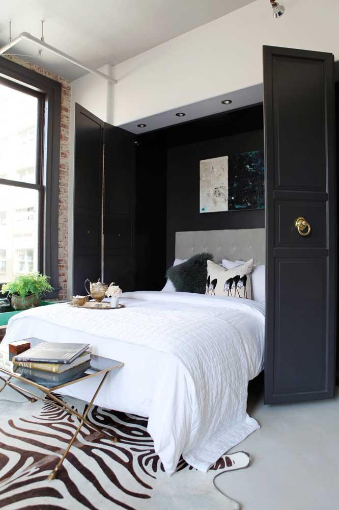 Quem disse que não dá para ter um quarto pequeno com as cores preta e branca?
