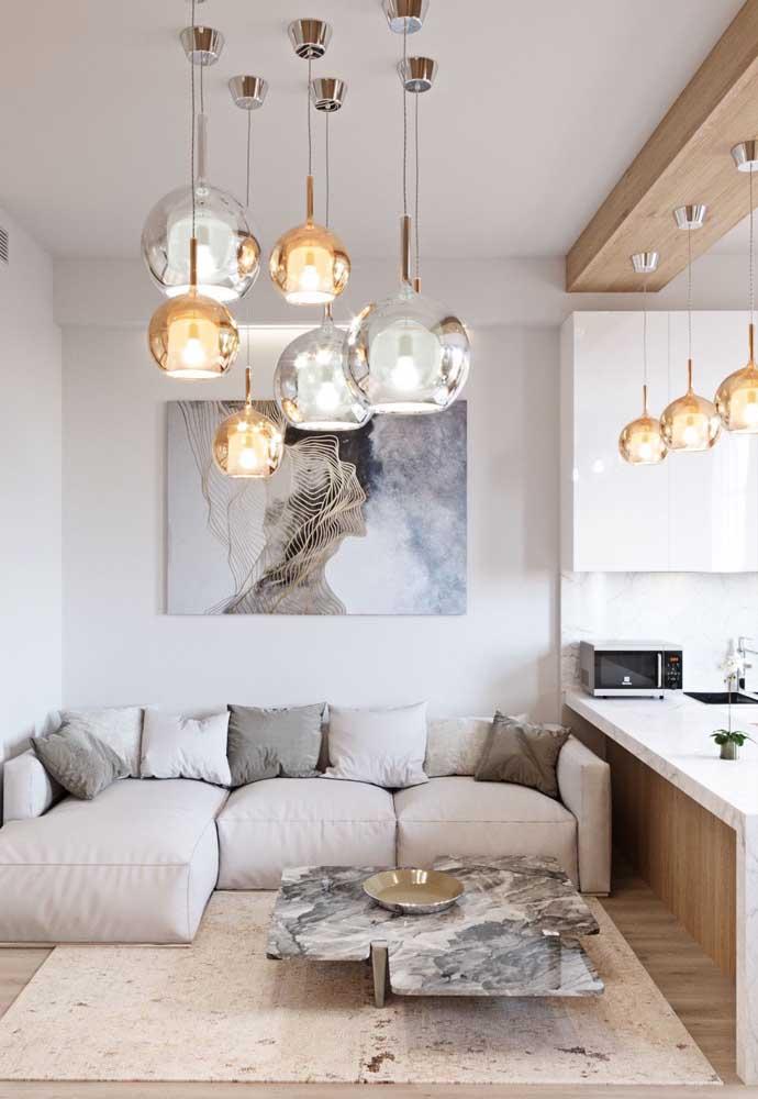 Veja que bela decoração da cozinha americana com sala de estar.