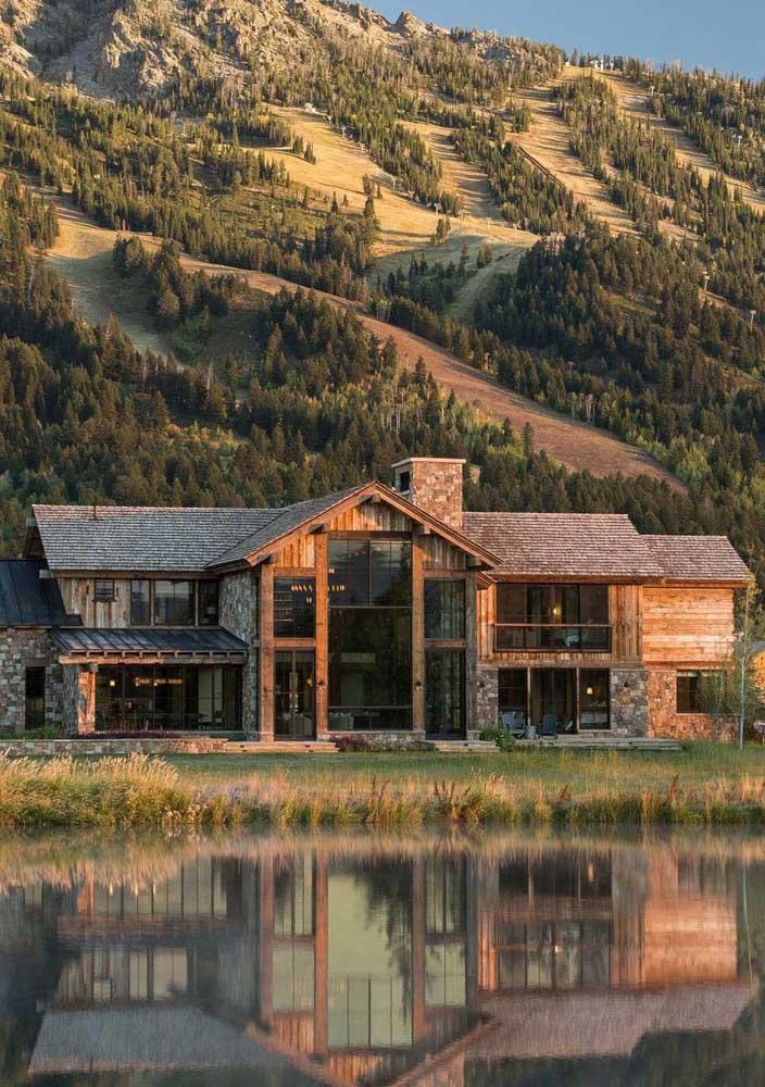 Casa de campo de madeira com vista para o lago uma paisagem deslumbrante em volta